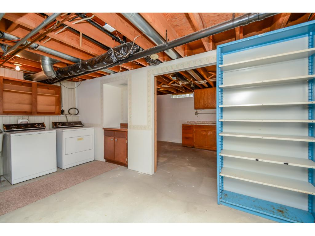 2 extra storage rooms in the lower level plus separate entrance to the yard.  Use as a duplex, roommate or mother in law suite?