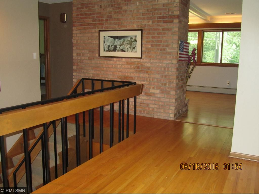 Large, inviting foyer, open staircase to lower level walk-out