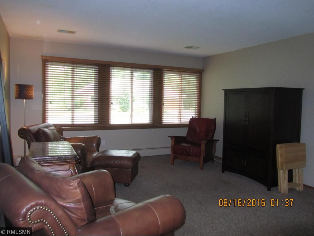 Living room, wood blinds stay with property