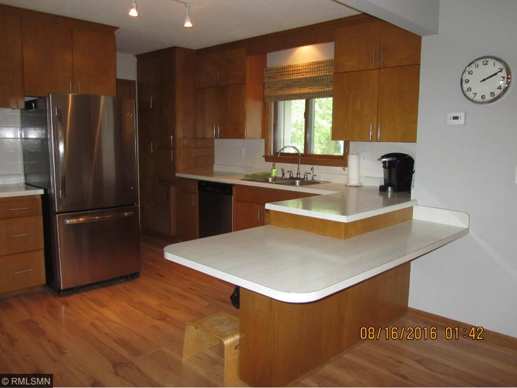 Kitchen, natural wood cabinets, wood floor, convenient work space