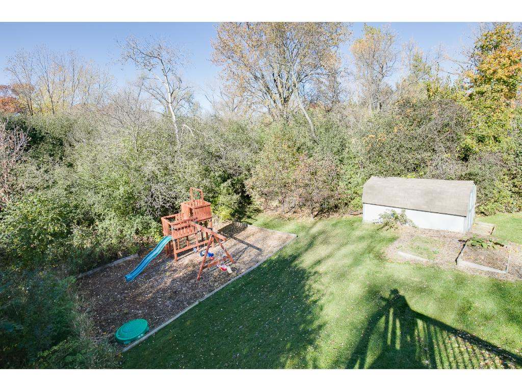 Large beautiful private backyard.  The shed and the playset are included in the sale of this home.
