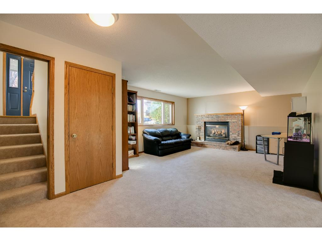 The family room features large window and a gas fireplace.