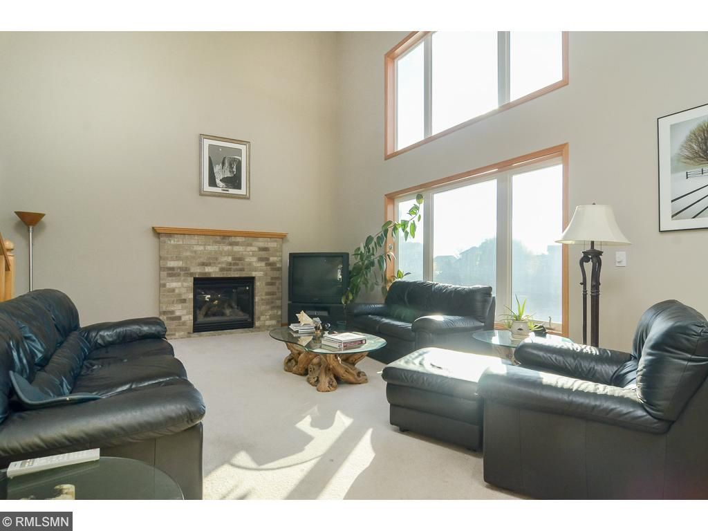Great room features an impressive stone fireplace and plenty of natural light!