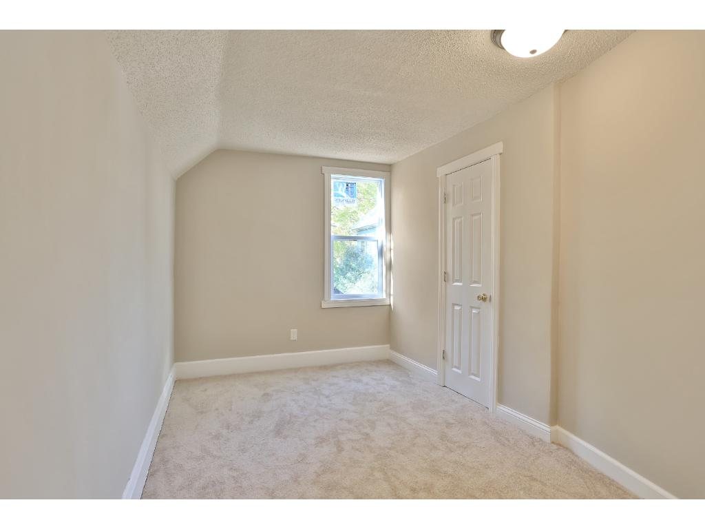 Upstairs bedroom with brand-new carpeting and ENERGY STAR window.
