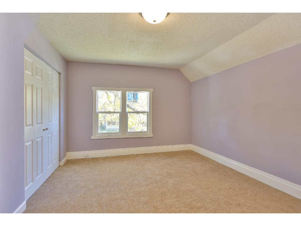 Upstairs bedroom with brand-new carpeting and ENERGY STAR windows.