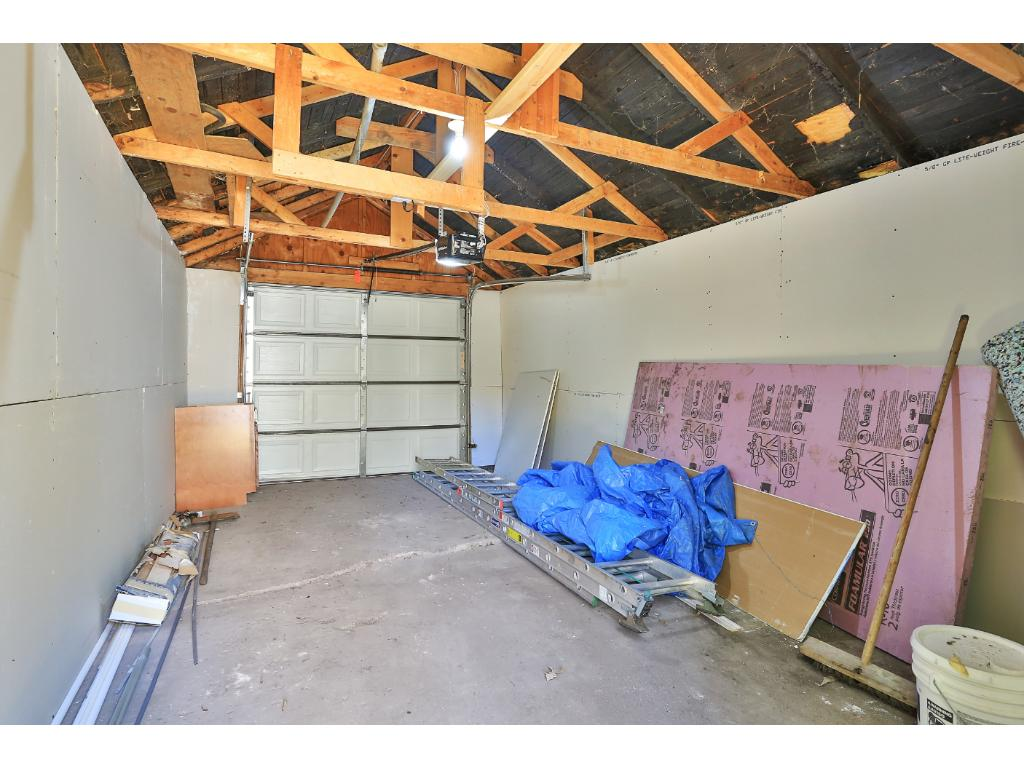 Detached one-car garage with fire-rated Sheetrock and new garage door with opener.