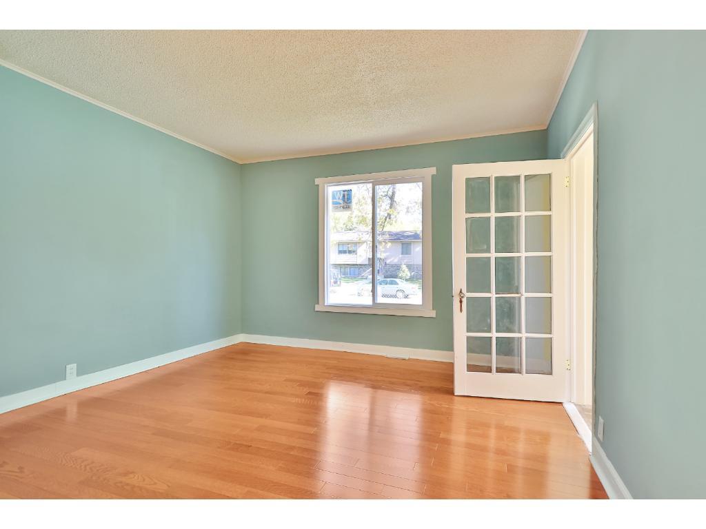 Living room with brand-new hardwood flooring.