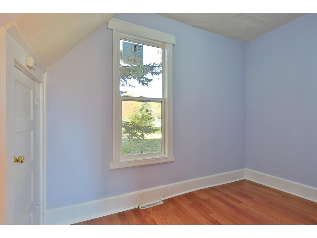 Main floor bedroom with brand-new hardwood flooring and ENERGY STAR window.