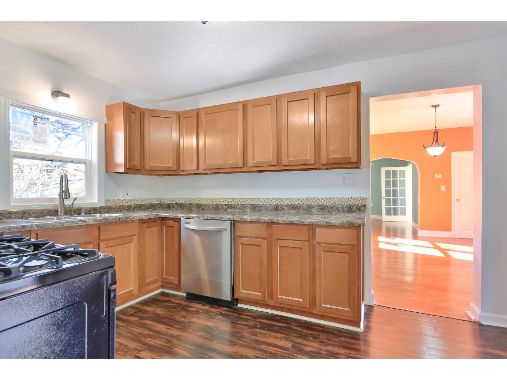 Beautiful kitchen with new cabinets, countertop, vinyl flooring and appliances.