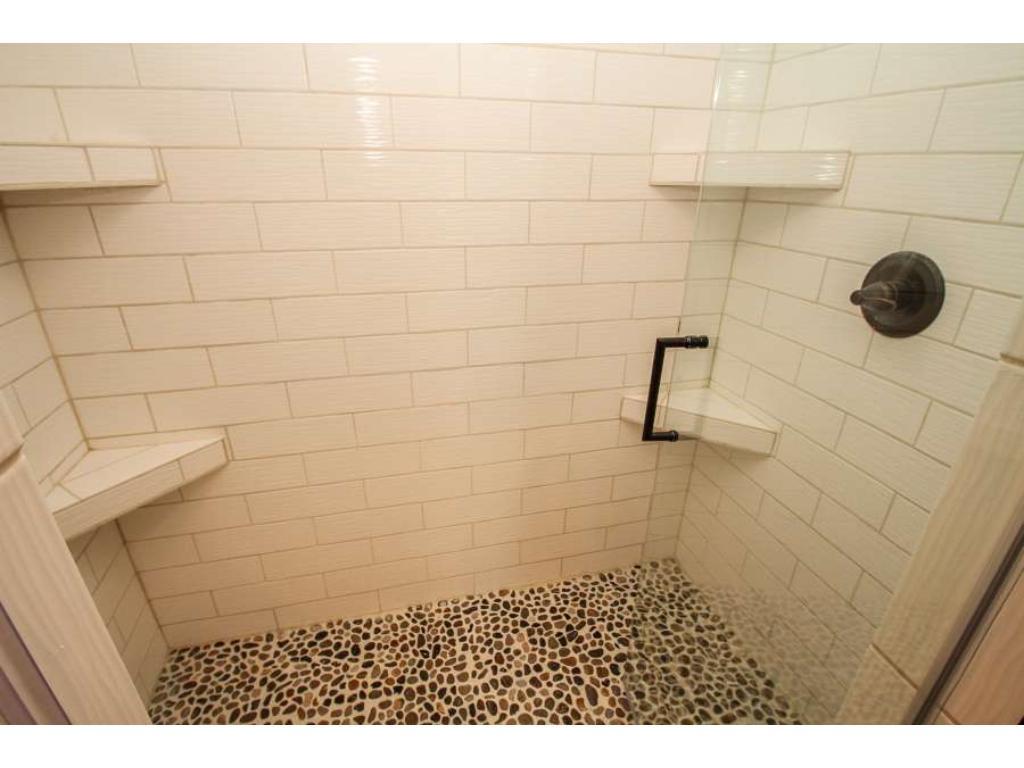 Beautiful subway tile shower.