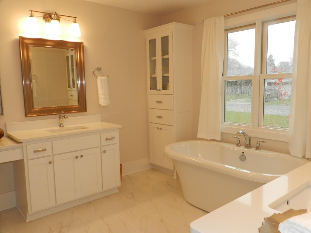 The deluxe 11x14 Master Bedroom Private bath features opposite dual vanities with quartz countertops, 2 linen cabinets, and separate soaking tub and walk-in shower.