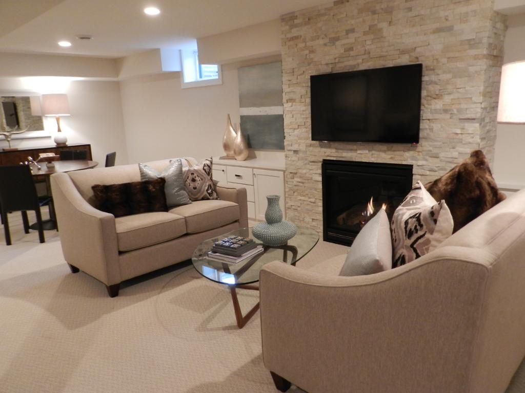 The Hearth area is across from the TV area. Perfect spot to snuggle up in the colder winter months to warm up by the gas fireplace, sip on your favorite beverage, and watch your favorite movie. Built-in cabinets flank both sides of the fireplace.