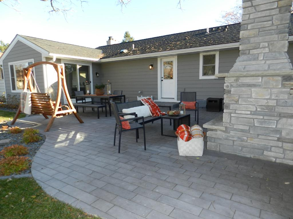 Magazine-quality 18x36 paver outdoor living room with wood-burning fireplace. Perfect for hosting backyard events and barbecues. Access from the Sun Room or back door by the Kitchen.