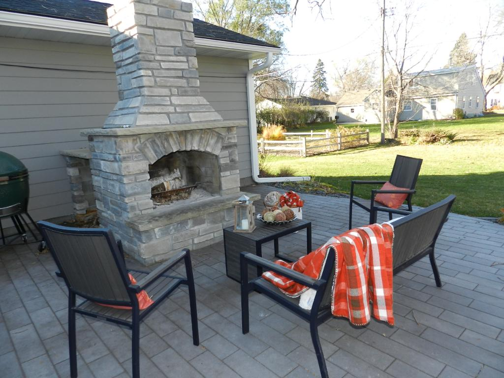 The outdoor wood-burning fireplace.