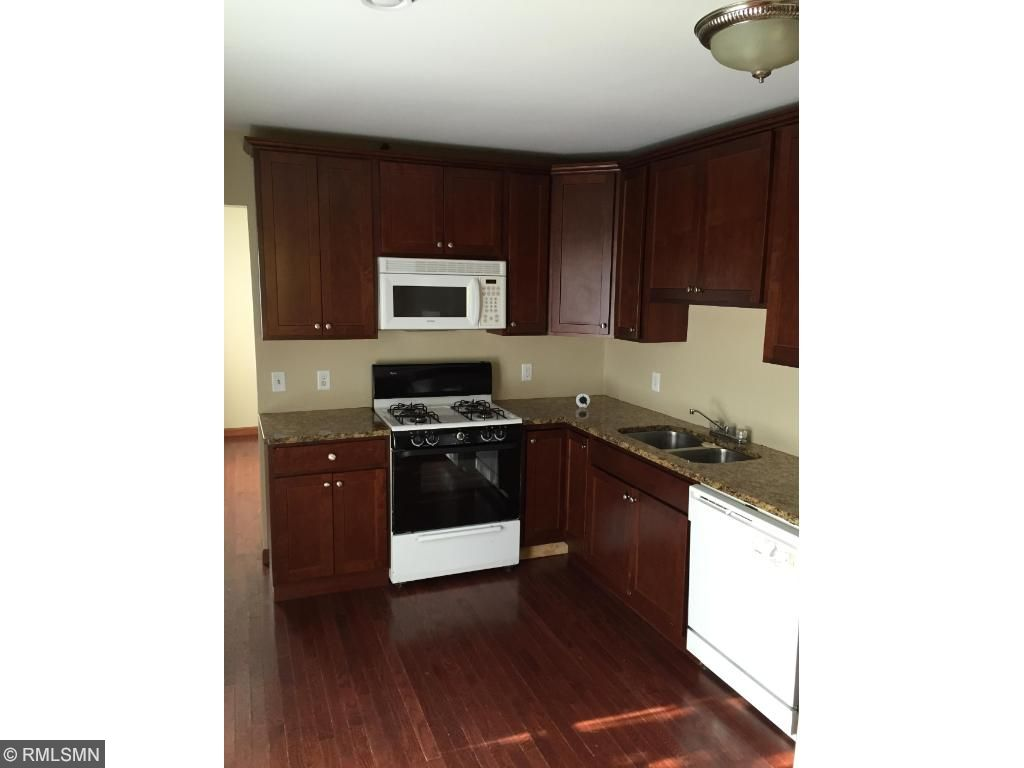 Kitchen is 3 years old and has maple cabinets and granite counter tops
