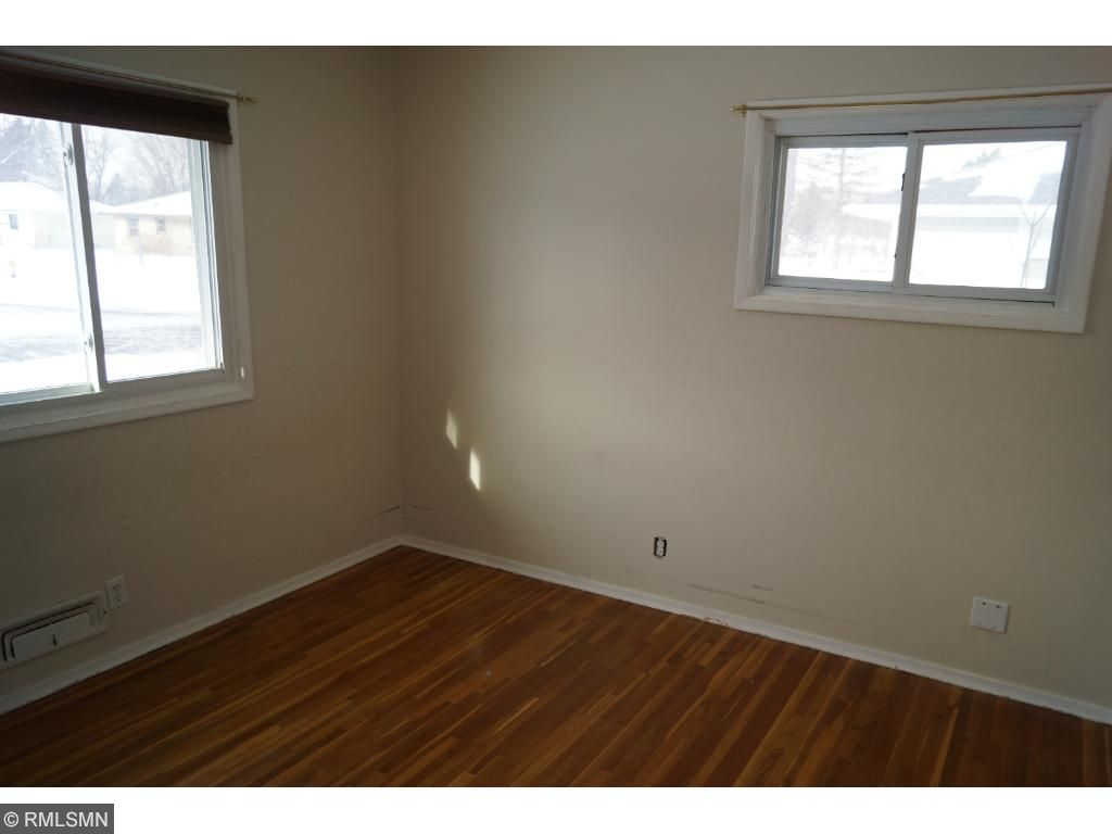 New bath in lower level with double vanities and adjacent to large bedroom with egress window.