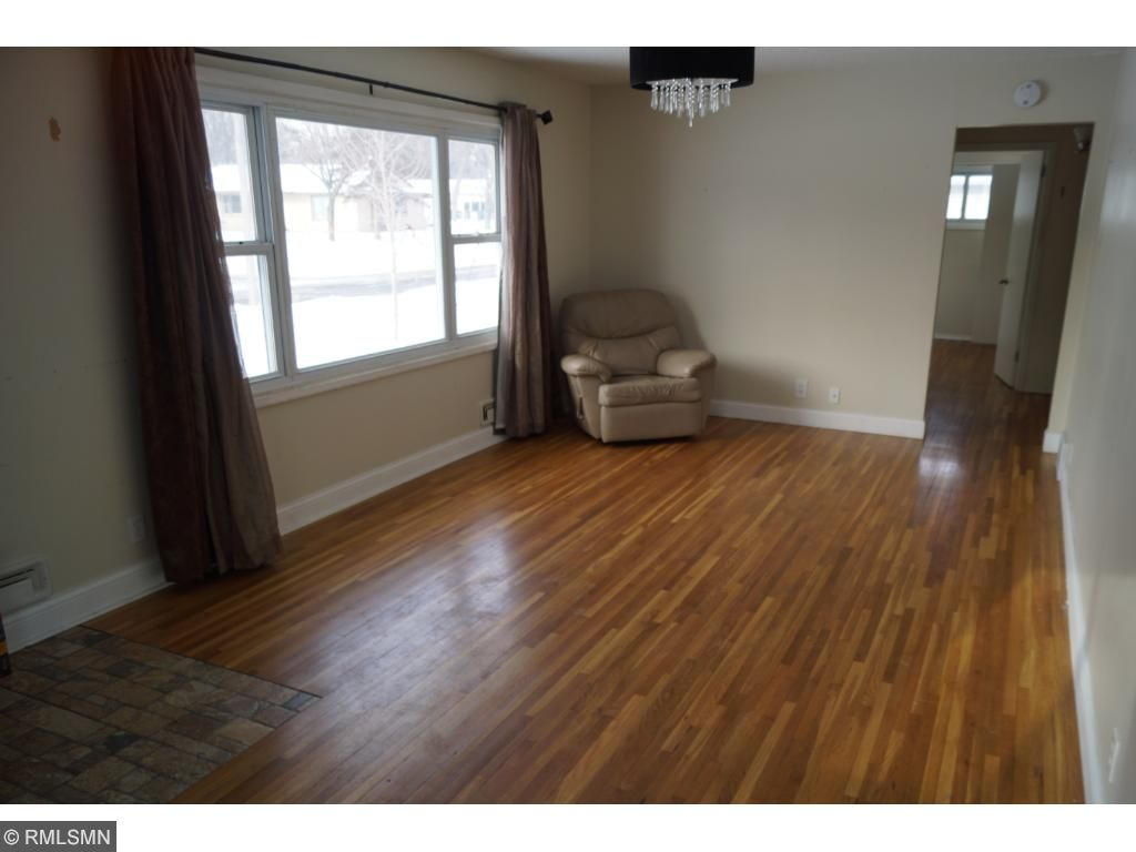 Hardwood floors in spacious living room.