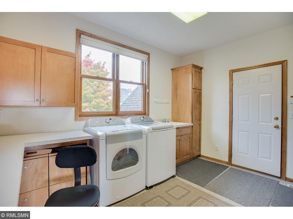 Large mud/laundry room on the main level serves a practical purpose along with a little desk area for quick tasks before walking out the door.