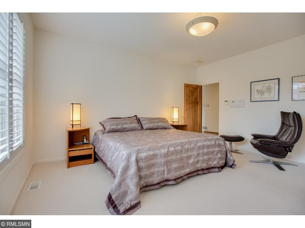 Ample main floor owner's suite has ample room and modern style.