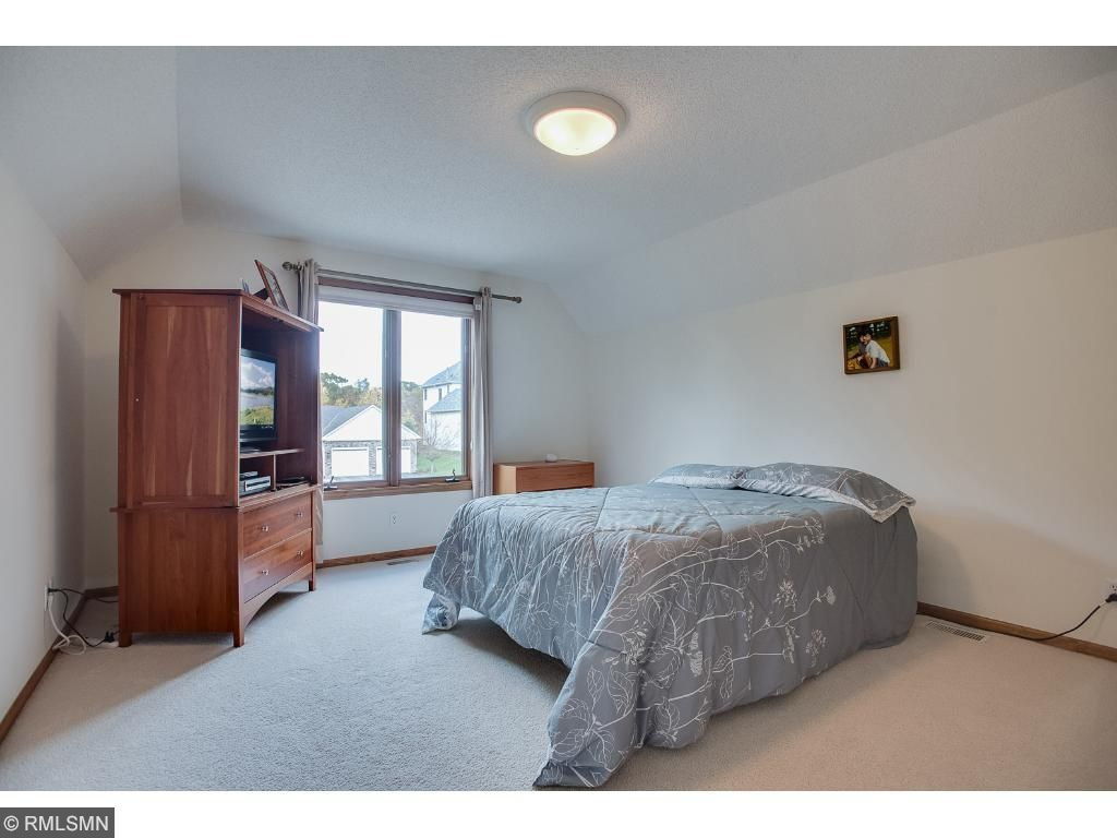 Upper level 2nd bedroom has private full bath, could also make an excellent den. Located just up a half flight of stairs, it feels like a separate apartment.