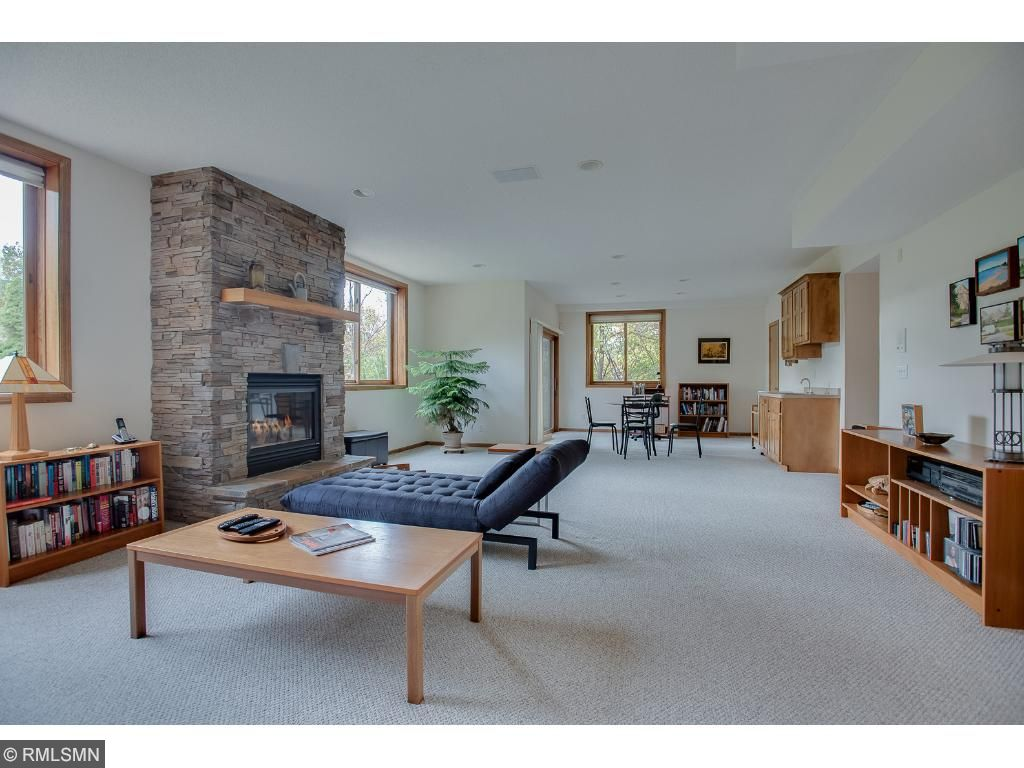 Large lower level walk-out family room has high ceilings and large windows for plenty of natural light.