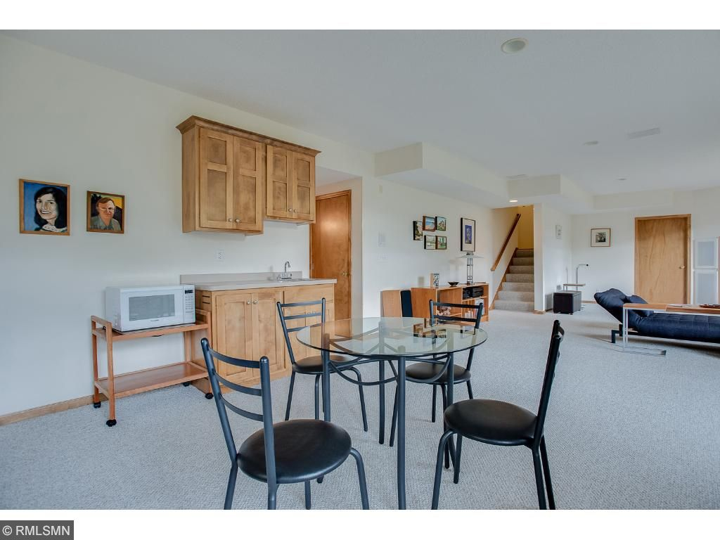 Lower level family room is ideal for entertaining with wet bar and 3/4 bath.