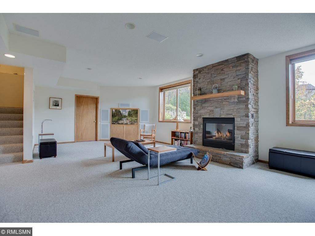 Family room has built in media center and cozy stone fireplace. Perfect combination for chilly nights in.