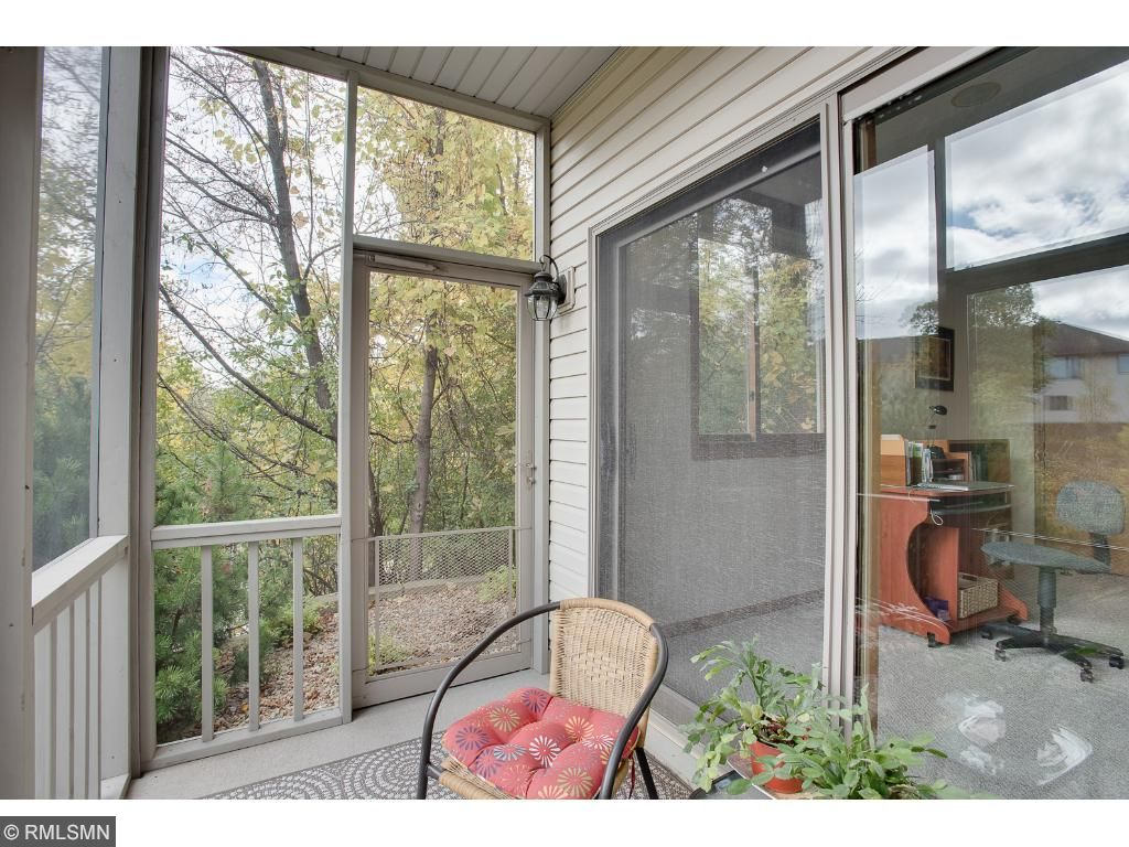 Lower level patio has been screened in for comfort. Enjoy the views and sounds of nature pest free.