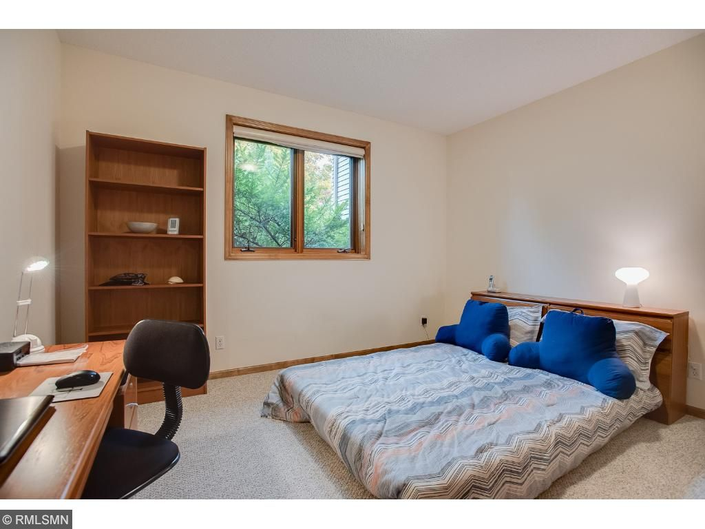 Secluded lower level bedroom is close to the 3/4 bath and would be ideal for an older child or family member.
