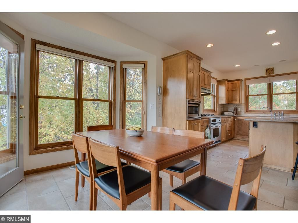 Kitchen/dining adds to the casual open feel of the main level with beautiful views of natures backdrop through large Marvin windows.