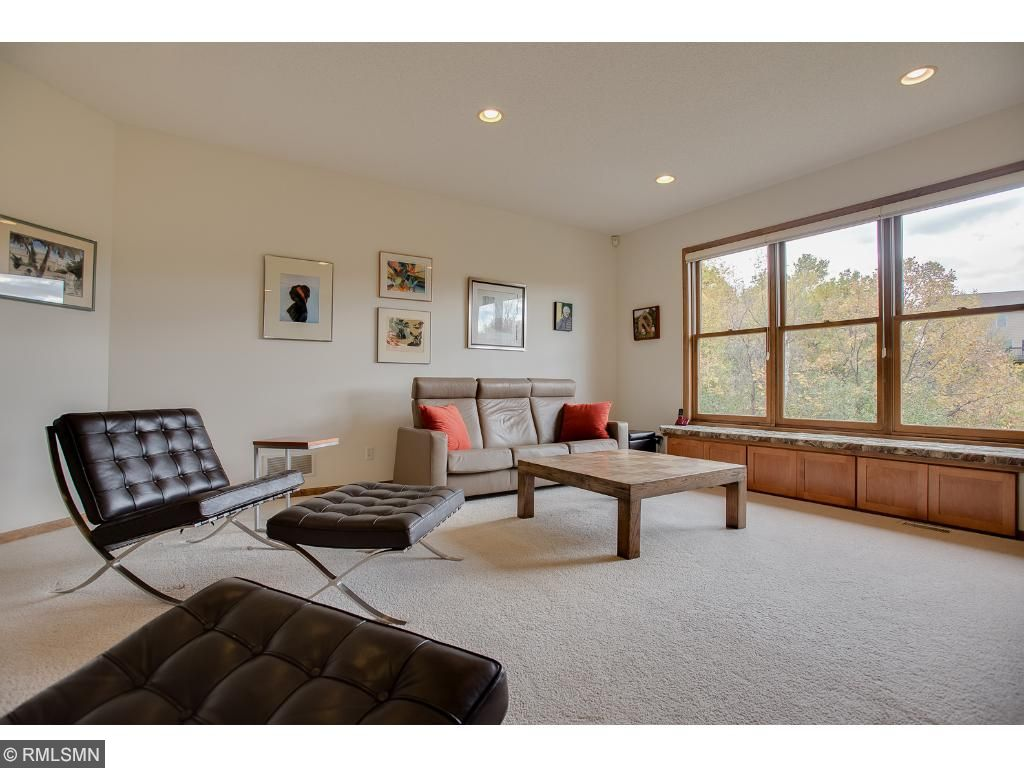 Main floor living room receives spectacular south exposed sunlight. Enjoy sitting on the built-in window seating to observe the natural wildlife outdoors.