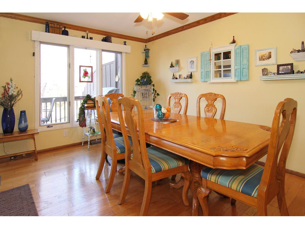 Large informal dining room just off the kitchen with door leading out to the deck.