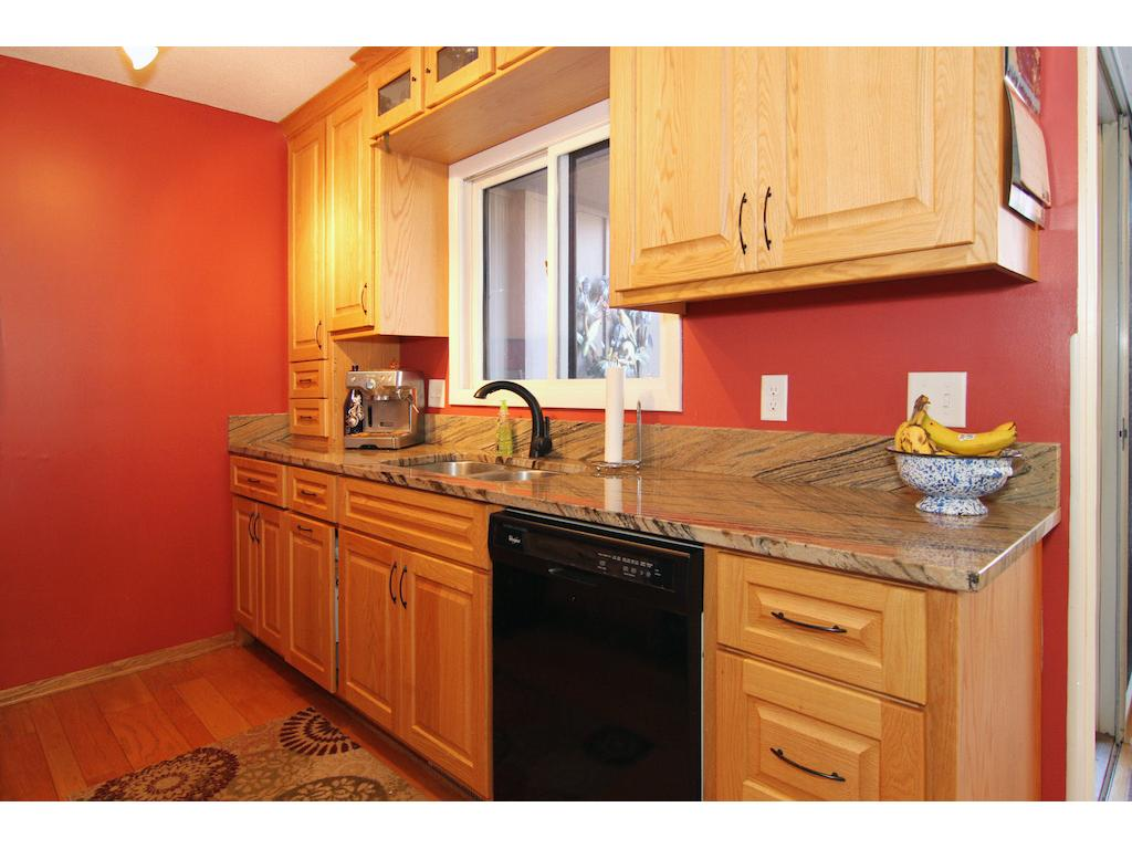 Updated kitchen with hardwood floors, updated cabinets, new appliances and granite counters.