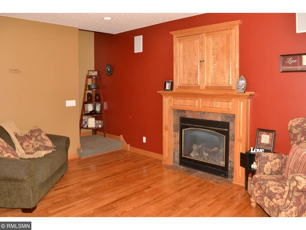 Main level gas fireplace with television cabinets along with surround sound.