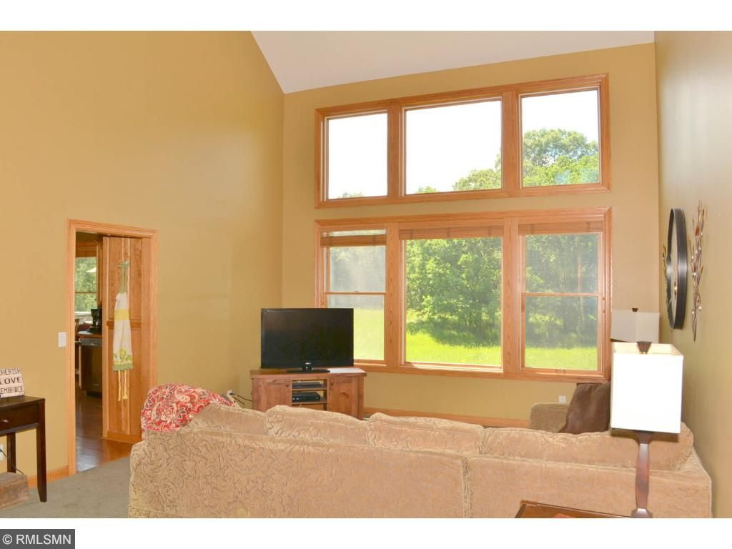 Family room with vaulted ceilings and absolutely prodigious glass wall for viewing all forms of wild life at play.