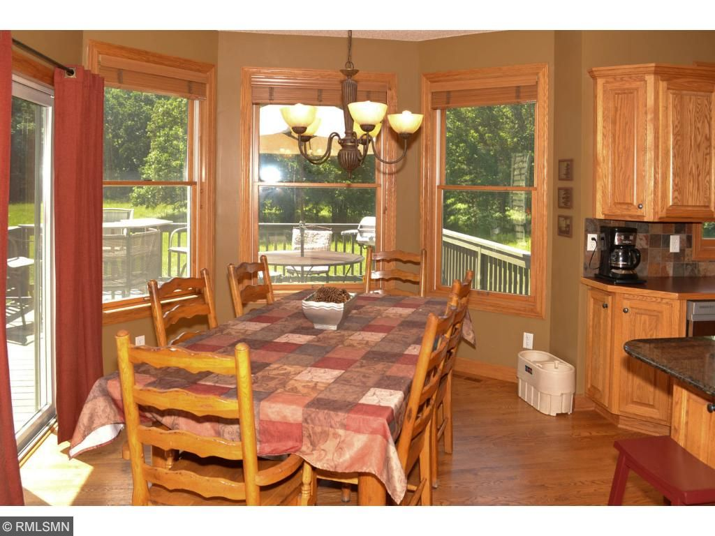 Eat in kitchen area with window views from all angles.