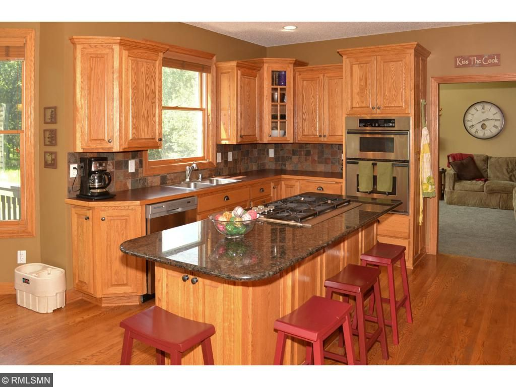 Granite counter tops and plenty of storage with the custom cabinets.
