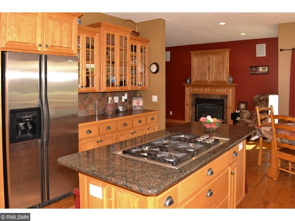 Gourmet cook top with exhaust fan and stainless steel appliances.