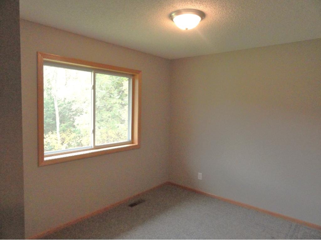 Second bedroom has new paint and carpet, and beautiful views of nature