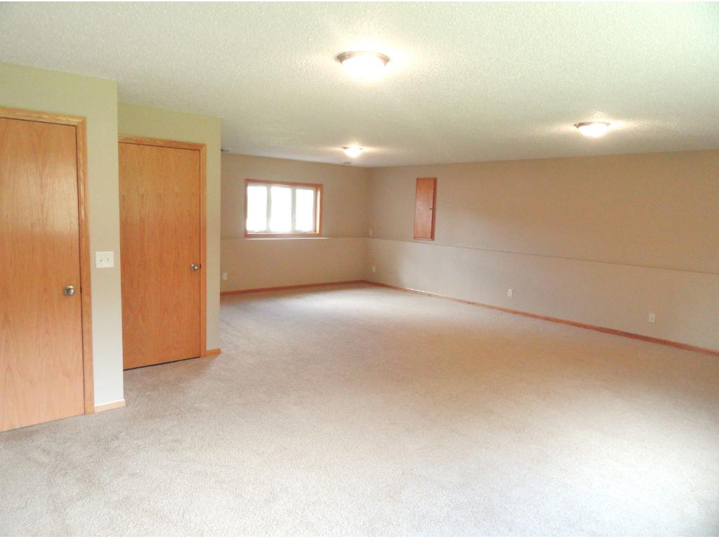 Lower level family room has two large windows for lots of light, and plenty of room.  Back window has views of nature.  No houses are behind home.