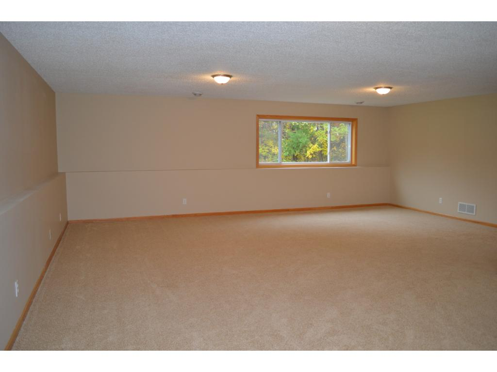 Another view of lower level family room.  Large windows gives you views of mature trees and large yard.