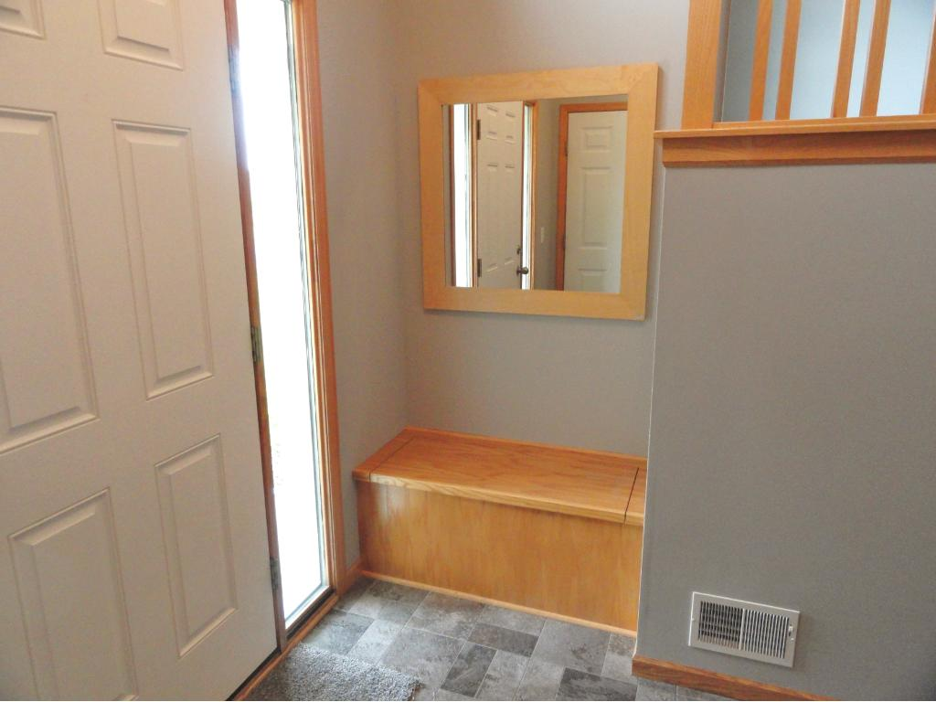 Built-in oak bench has storage space for shoes, boots, backpacks, etc.
