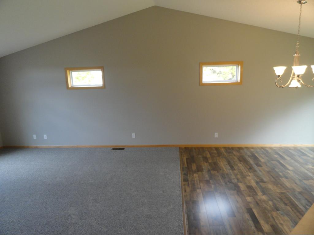 Another view of the living room and dining room area.