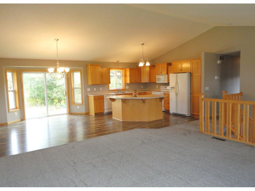Living room, kitchen and dining room are all vaulted and have an open floor plan.