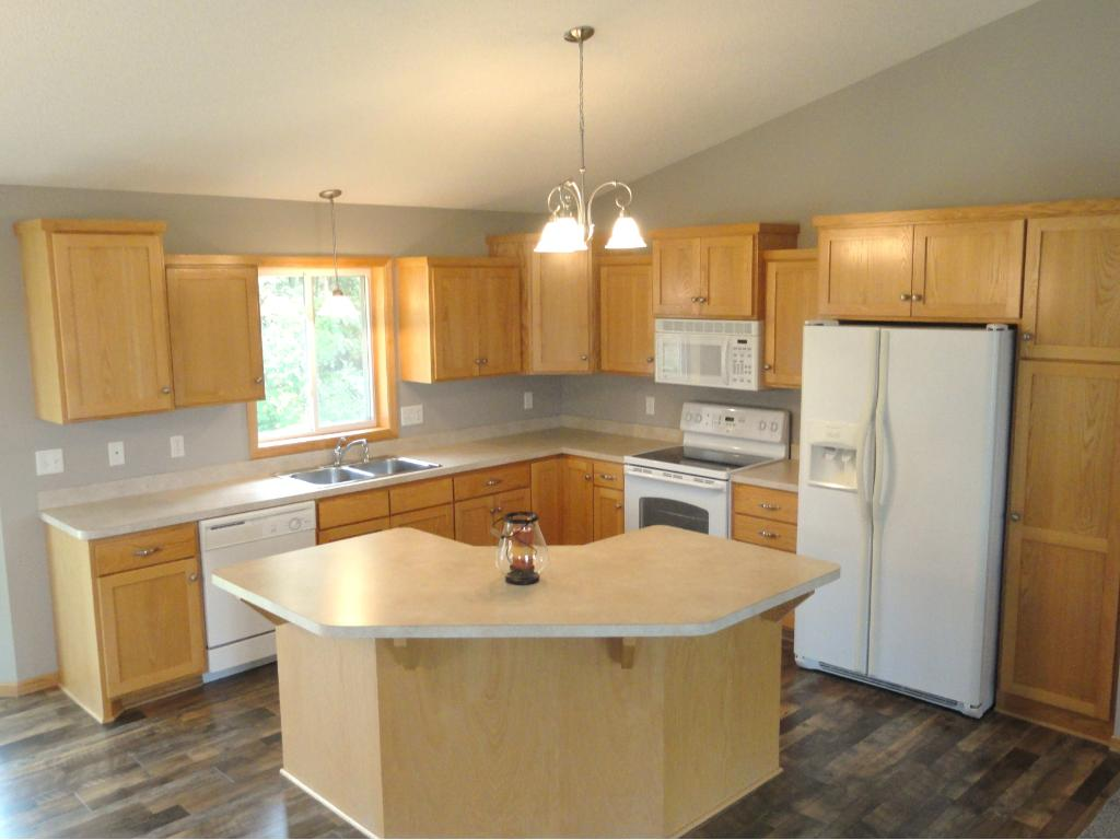 Kitchen has custom oak cabinets, center island and includes a pantry for extra storage.  Brushed nickel fixtures give this home a fresh feeling.