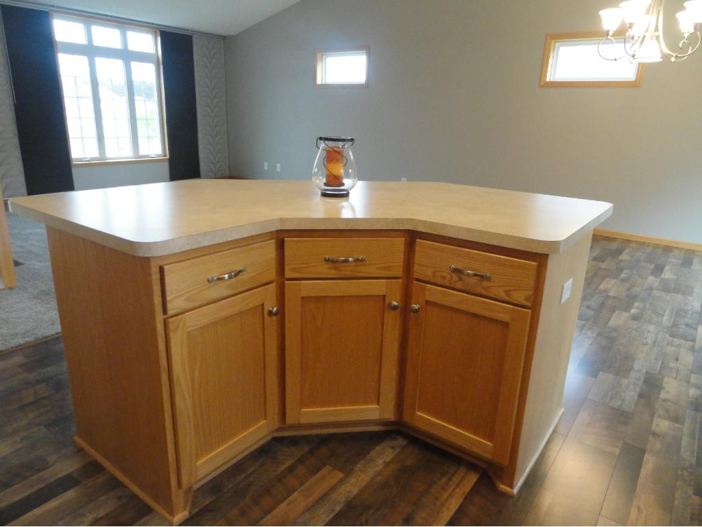 Cute custom built center island really adds character, and makes it easy to prep meals.