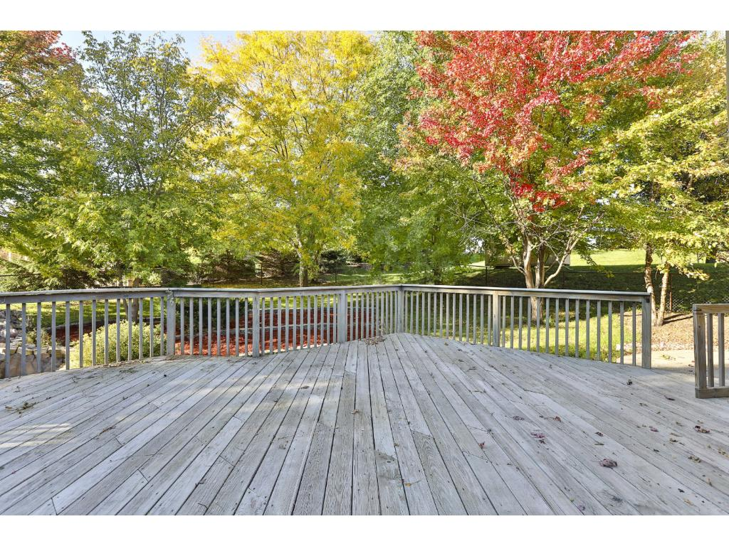 Large deck overlooks custom landscaped, private backyard!