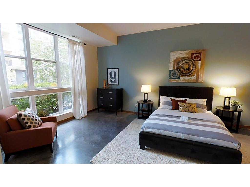 Very spacious master bedroom features an oversized sliding door and a wonderful walk in closet