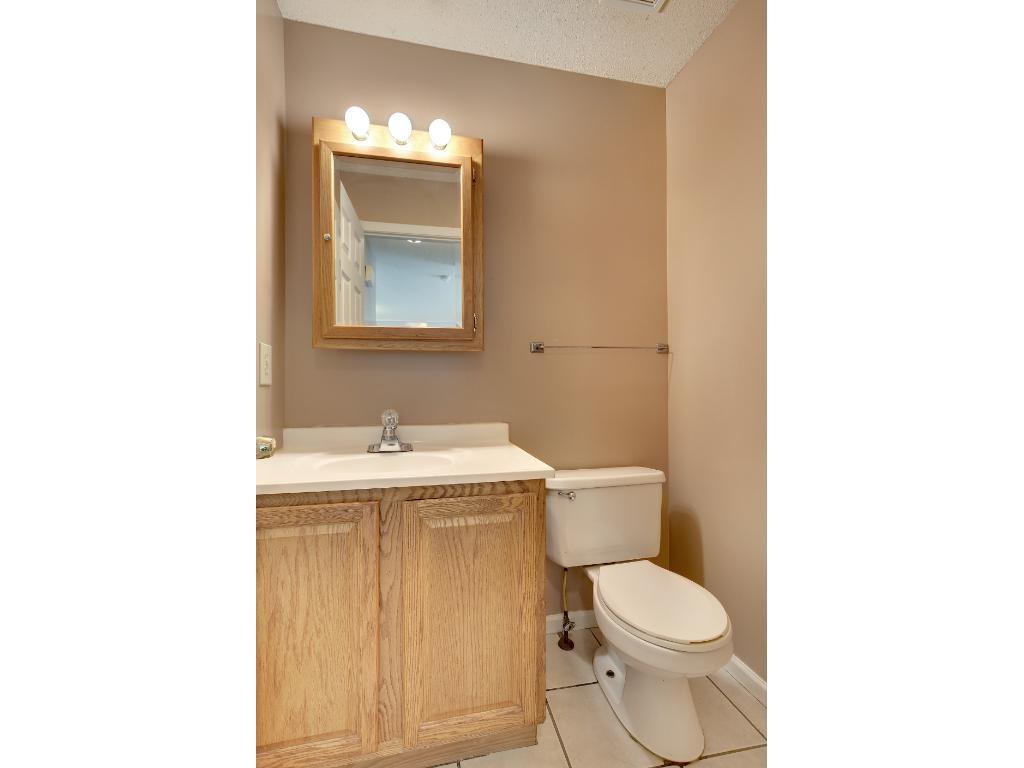 Main floor features 1/2 bath for convenience.