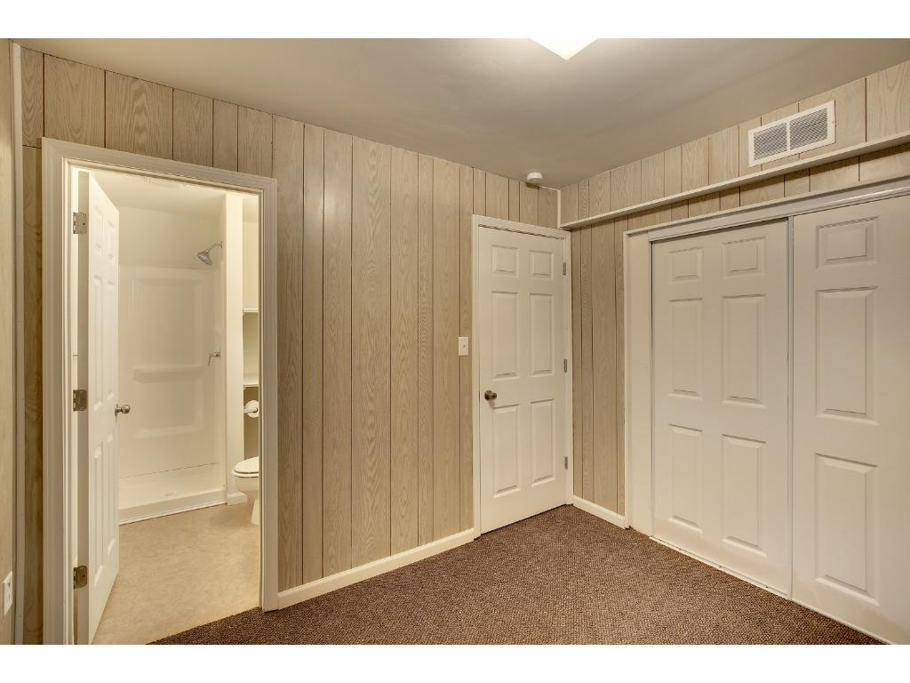 Basement bedroom also features large closet space